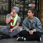 Russian Embassy,London,England,UK. 22th April 2017. LGBT community and supporters write a message oppose Chechnya opens world's first concentration camp for homosexuals since Hitler's in the 1930s where campaigners say gay men are being tortured with electric shocks and beaten to death outside Russia Embassy. by See Li