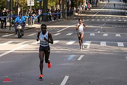 Mary Keitany, KEN, adidas<br /> trails eventual winner Jepkosgei on Fifth Avenue at mile 23<br /> TCS New York City Marathon 2019