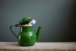 Teapot with Euros inside (Credit Image: © Image Source/Ian Nolan/Image Source/ZUMAPRESS.com)