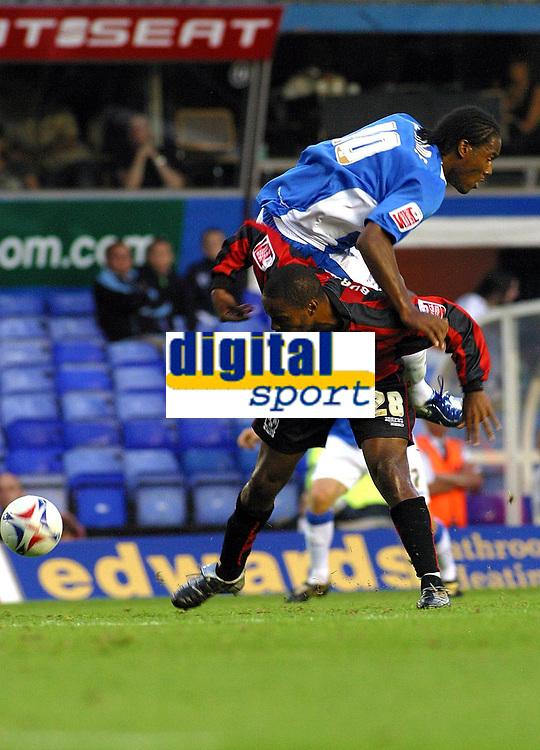 Photo: Dave Linney.<br />Birmingham City v Shrewsbury Town. Carling Cup. 22/08/2006.Birminghams Cameron Jerome(Top) hitches a lift from   Sagi Burton