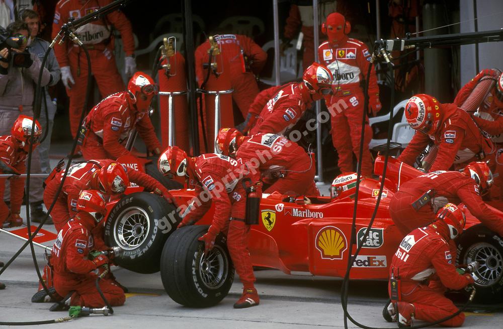 Pit-stop for Eddie Irvine (Ferrari) in the 1999 Malaysian Grand Prix in Sepang. Photo: Grand Prix Photo
