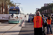"27 DECEMBER 2008 -- PHOENIX, AZ: The first official light rail train to arrive in Phoenix burst through a banner that read ""Phoenix Rising."" Metro Light Rail started running Saturday, Dec. 28. The light rail line is 20 miles long and cost $1.4 billion dollars. PHOTO BY JACK KURTZ"