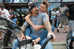 Custom bike builder Billy Lane with his wife Erin on Erin and Billy Lane on his Harley-Davidson Knucklehead bobber in front of the Main Street store he occupied with his bikes and parts during the 2015 Biketoberfest Rally. Daytona Beach, FL, USA. October 16, 2015.  Photography ©2015 Michael Lichter.