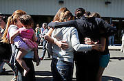 Oct 1, 2015 - Roseburg, Oregon, U.S. - <br /> <br />  Students arriving from campus are greeted by friends and family as they arrive at the fairgrounds. As many as 10 people were killed and 20 injured when a shooter opened fire at Oregon's Umpqua Community College on Thursday.<br /> ©Exclusivepix Media