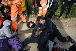 Security guards working on behalf of HS2 forcibly remove environmental activists from HS2 Rebellion from the road in front of a gate providing access to a site for the HS2 high-speed rail link on 12 September 2020 in Harefield, United Kingdom. Anti-HS2 activists continue to try to prevent or delay works on the controversial £106bn HS2 high-speed rail link in the Colne Valley where thousands of trees have already been felled.