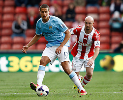 Manchester City's Jack Rodwell shields the ball from Stoke City's  - Photo mandatory by-line: Matt Bunn/JMP - Tel: Mobile: 07966 386802 14/09/2013 - SPORT - FOOTBALL -  Britannia Stadium - Stoke-On-Trent - Stoke City V Manchester City - Barclays Premier League