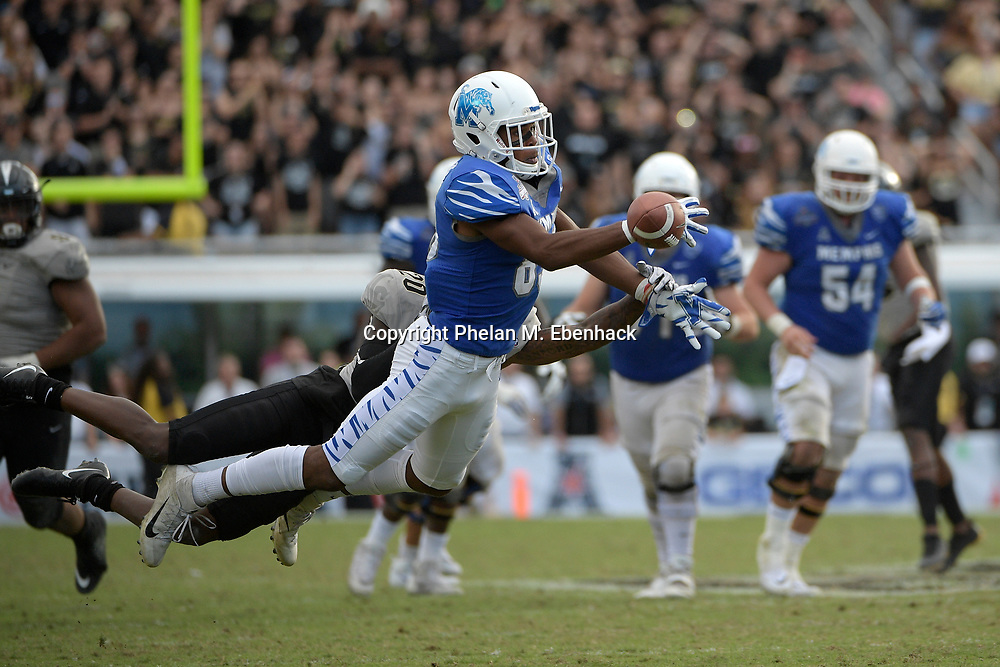 Memphis wide receiver Phil Mayhue (89) misses a pass as he is interfered with by Central Florida defensive back Brandon Moore (20) during the second half of the American Athletic Conference championship NCAA college football game Saturday, Dec. 2, 2017, in Orlando, Fla. Central Florida won 62-55. (Photo by Phelan M. Ebenhack)