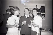24/06/1965<br /> 06/24/1965<br /> 24 June 1965<br /> Gilbeys Ireland Ltd. reception at Gilbey's Wine Merchants, Nos. 46-49 O'Connell St., Dublin, for the presentation of a consignment of Dry Monopole Champagne to the organisers of Le Bal des Petits Lits Blancs. Image shows Mr. David I. Dand (centre), Director, Gilbeys of Ireland Ltd. tasting the wine with hostesses Christine Davies (left) and Audrey Poynton.