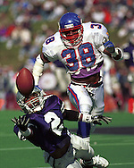 Kansas State wide receiver Andre Colman (2) reaches for a pass against Kansas during game action at KSU Stadium in Manhattan, Kansas in 1993.