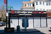 Brooklyn, NY - 15 April 2020. Brooklyn's Best Eats, on Hillel Place near Brooklyn College, is shuttered for now. Stores and restaurants near Brooklyn College in Brooklyn's Midwood Neighborhood close in response to orders for non-essential businesses to close. Some food businesses tried to remain open for takeout, but could not afford to, especially after the college closed.