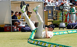 England's Craig Overton crashes into the boundary rope during day three of the Ashes Test match at the WACA Ground, Perth.