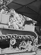 5586Tractor driver, Alice Pimley at the E. Clemens Horst hop ranch near Independence, Oregon. September 1, 1942.