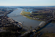 Nederland, Gelderland, Nijmegen, 07-03-2010; Waalsprong: aan de noordoever van de Waal (rechts), rond het dorp Lent, zal een nieuw stadsdeel gebouwd gaan worden. Ook zal er in de toekomst op deze lokatie een geul uitgegraven worden (meer landinwaarts ten opzicht van de rivier), om de rivier meer de ruimte te geven. Lent (aan de dijk) komt dan op een eiland te liggen..Waalsprong (Waaljump): on the north bank of the Waal, around the village of Lent, a new city will be built.Furthermore, in the near future a flood channel will be excavated on this location, to provide the river with more space (because of high water / flooding problems). Lent, on the dike, will become an island.luchtfoto (toeslag), aerial photo (additional fee required).foto/photo Siebe Swart