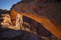 Warm light at sunrise on Mesa Arch, Canyonlands National Park, Utah