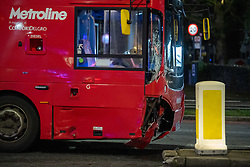 © Licensed to London News Pictures. 30/01/2021. London, UK. A damaged double decker bus on the A40. A road traffic collision between a car and a bus closed the busy A40 at the junction of Wales Farm Road in Acton, the collision occurred at approximately 22:30GMT. Photo credit: Peter Manning/LNP