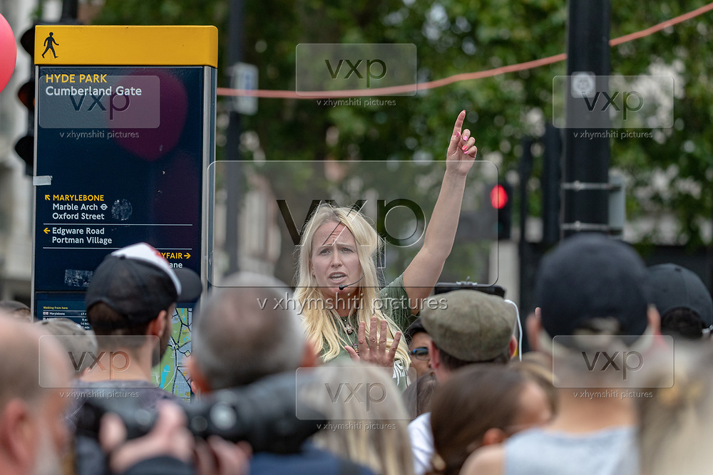 An activist that opposes WHO (World Health Organisation) and Government guidance measures to curb the spread of Coronavirus pandemic outbreak speaks in front of people who attend a protest against the wearing of masks during the coronavirus outbreak near Marble Arch in Central London on Sunday, July 19, 2020. (VXP Photo/ Vudi Xhymshiti)