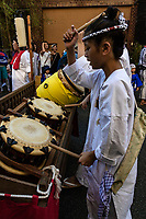 Drummers at Mengake Kamakura - Mengake or Masked Parade at Goryo Jinja shrine.  At this festival held in September a group of ten people take part in this annual ritual: 8 men and 2 women. Wearing comical or grotesque masks that signify different demons, legends and dieties  leave the shrine and parade through the nearby streets accompanied by portable shrine and festival music.