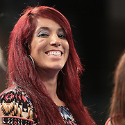 Female boxer Noemi Bosques laughs at ringside during a Telemundo boxing  event at the Kissimmee Civic Center on Friday, July 17, 2015 in Kissimmee, Florida.  (AP Photo/Alex Menendez)