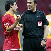 Referee's Bunyamin GEZER (R) during their Turkish superleague soccer derby match Galatasaray between Trabzonspor at the TT Arena in Istanbul Turkey on Sunday, 10 April 2011. Photo by TURKPIX