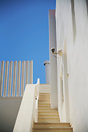 Detail view of a white building at Figueretes beach on August 21, 2020 in Ibiza, Spain. Almost all Schengen countries recommend not traveling to Spain due to COVID -19. The quarantine imposed by the United Kingdom has been decisive, many establishments have not opened and the average occupancy is less than 50%.