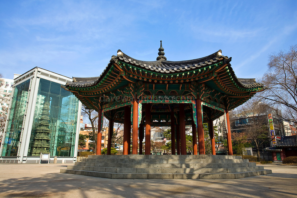 Palgakjeong Pavilion at Tapgol, or Pagoda Park, Seoul, South Korea. This was the site where the Korean Declaration of Independence was read aloud on March 1st, 199 - and the start of March First Independence Movement. To the left is Wongaksa Pagoda.