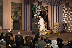 April 28, 2017 - Cairo, Egypt - Pope Francis hugs Sheikh Ahmed el-Tayeb, Grand Imam of Al-Azhar, the pre-eminent institute of Islamic learning in the Sunni Muslim world, in Cairo Egypt, Friday, April 28, 2017. Francis is in Egypt for a two-day trip aimed at presenting a united Christian-Muslim front that repudiates violence committed in God's name. (Credit Image: © Fayed El-Geziry/NurPhoto via ZUMA Press)