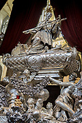 The tomb of Johann Nepomuk in St Vitas Cathedral in Prague Castle, on 18th March, 2018, in Prague, the Czech Republic. The Metropolitan Cathedral of Saints Vitus, Wenceslaus and Adalbert is a Roman Catholic metropolitan cathedral in Prague, the seat of the Archbishop of Prague. Until 1997, the cathedral was dedicated only to Saint Vitus, and is still commonly named only as St. Vitus Cathedral. This cathedral is a prominent example of Gothic architecture and is the largest and most important church in the country. It is located within Hradcany-Prazsky Hrad Prague Castle in the Czech capital.