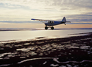 Glenn Hittson and Tom Brower flying in Piper PA18 Super Cub, toward Dease Inlet from Barrow, Arctic Ocean, Alaska'
