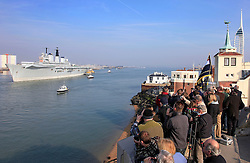 © under license to London News Pictures.  24/03/2011 Crowds watch as HMS Invincible is towed from Portsmouth Dockyard on her final journey. She is to be delivered to Turkey where she will broken up for scrap. Picture credit should read: Bryan Moffat/London News Pictures