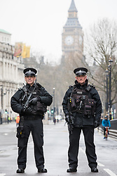 © Licensed to London News Pictures. 23/03/2017. London, UK. Armed police stand guard on Whitehall the morning after the Westminster attack in which five people are believed to have died. Photo credit: Rob Pinney/LNP