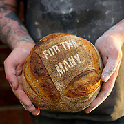 A baker holds a loaf of bread made to mark the occasion of the UK General Election at the Haxby Bakehouse, Yorks artisan bakery in Haxby, North Yorkshire, United Kingdom on 10th December 2019.