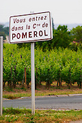 Road sign saying 'Vous entrez dans la commune de Pomerol' (you are entering the commune of Pomerol) Pomerol Bordeaux Gironde Aquitaine France