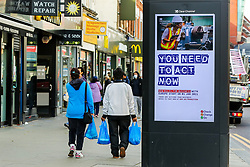 © Licensed to London News Pictures. 19/10/2020. London, UK. Shoppers in north London walk past the government's publicity campaign 'YOU NEED TO ACT NOW' for firms that trade with Europe to prepare for a no-deal Brexit. HMRC will contact over 200,000 firms that trade with the EU to set out the new customs and tax rules and how to deal with them. Photo credit: Dinendra Haria/LNP