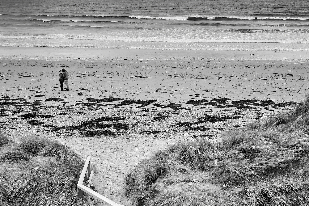Love on Dunnet Beach, nearly as far north on the UK mainland this black and white image captures a moment of love for this couple in the exposed far north of Scotland.<br /> <br /> Photo by Jonathan J Fussell, COPYRIGHT 2017