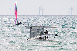 © Licensed to London News Pictures. 09/09/2016. Brighton, UK. Members of the Brighton and Hove Sailing Club battle the waves righting their catamaran after it capsizes by the strong winds. Photo credit: Hugo Michiels/LNP
