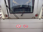 Warning signs on the window sill a train.