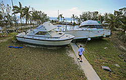 Chris Morgan inspects the large boats that beached onto the property she in stayed during Hurricane Irma's storm surge in Key Largo, FL, USA, on Tuesday, September 12, 2017. Photo by Al Diaz/Miami Herald/TNS/ABACAPRESS.COM