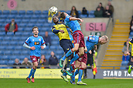 Oxford United Defender, Cheyenne Dunkley (33) with a header from a corner during the EFL Sky Bet League 1 match between Oxford United and Scunthorpe United at the Kassam Stadium, Oxford, England on 18 March 2017. Photo by Adam Rivers.