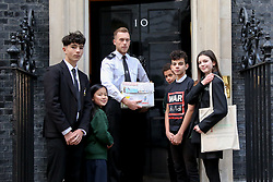 November 19, 2018 - London, United Kingdom - A group of school children are seen handing a petition by the Child War to the Prime Minister..The petition is a ''Learn to live campaign'' which urges the British Prime Minister Theresa May and other world leaders to better support the mental health and the emotional needs of the children affected by conflict. Even when children escape the bombs, the trauma of war can stay with them for years. (Credit Image: © Dinendra Haria/SOPA Images via ZUMA Wire)