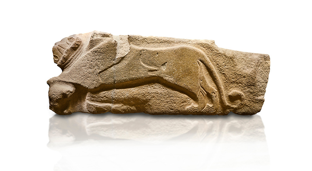 Alaca Hoyuk - Hittite lion sculptures corner Stone. . Andesite. Alacahoyuk, 1399 - 1301 B.C. Anatolian Civilisations Museum, Ankara, Turkey.<br /> <br /> Corner stone decorated by lion, bull and winged sun disk. It was discovered at the right side of the Alacahoyuk sphinx door. The lion puts his front legs on a small bull. There is a Hittite winged sun disk on the abdomen of the lion, which can be seen from a lower location. The position of the sun course indicates that the stone is situated in a high place. <br /> <br /> Against a white background. .<br />  <br /> If you prefer to buy from our ALAMY STOCK LIBRARY page at https://www.alamy.com/portfolio/paul-williams-funkystock/hittite-art-antiquities.html . Type - Aalca Hoyuk - in LOWER SEARCH WITHIN GALLERY box. Refine search by adding background colour, place, museum etc.<br /> <br /> Visit our HITTITE PHOTO COLLECTIONS for more photos to download or buy as wall art prints https://funkystock.photoshelter.com/gallery-collection/The-Hittites-Art-Artefacts-Antiquities-Historic-Sites-Pictures-Images-of/C0000NUBSMhSc3Oo