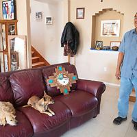 Davis Coonis, Zuni Pueblo Artwalk featured artist photographed in his home Thursday, Oct. 24 in Zuni Pueblo with a Zuni Sunface piece.