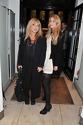 Left to right, HELEN LEDERER and her daughter HANNAH LEDERER-ALTON at a party to celebrate the switching on of the Christmas Lights at the Stella McCartney store, Bruton Street, London on 29th November 2011.