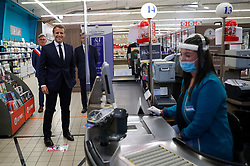 A cashier jokes with French President Emmanuel Macron as he visits a Super U supermarket about the partnership with local producers in Saint-Pol-de-Leon during a day trip centered on agriculture amid the coronavirus disease (COVID-19) outbreak in Brittany, France, April 22, 2020. Photo by Stephane Mahe/Pool/ABACAPRESS.COM