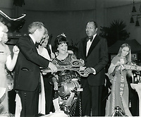 """1979 (L to R) Ted Mann, Councilwoman Peggy Stevenson & Mayor Tom Bradley during the grand opening of Mann's Chinese Theaters #2 & #3 and the premiere of """"Hurricane"""""""