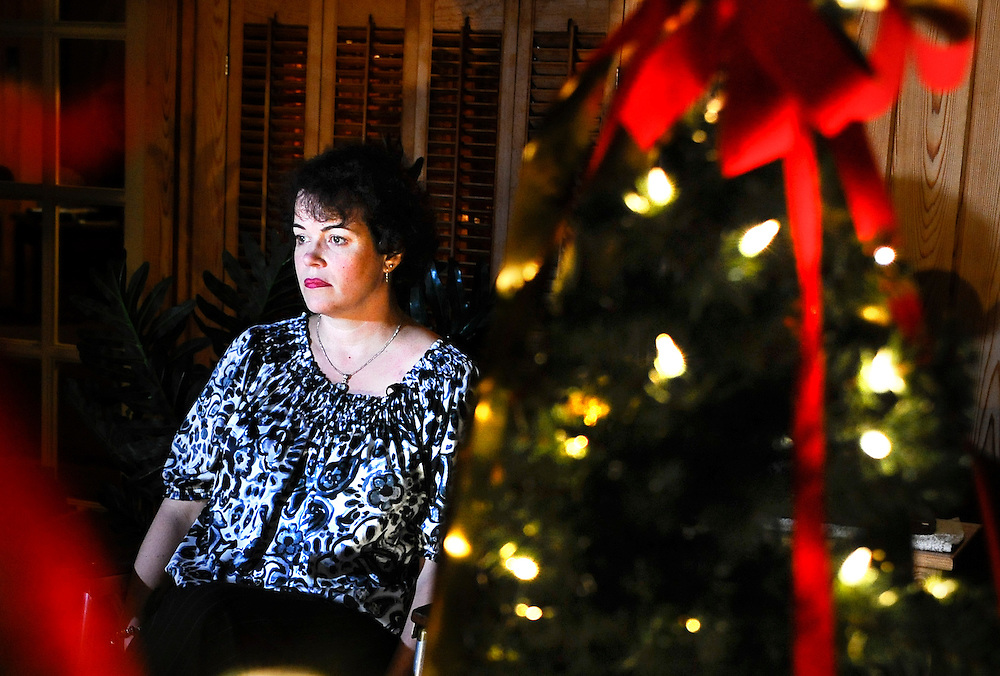 In this Monday, Jan. 14, 2013 photo, Veronique Pozner sits next to a decorated tree, picked out by her son Noah, at a friend's house during an interview with The Associated Press in Danbury, Conn.  Pozner's son Noah was a victim of the Sandy Hook Elementary School shooting in Newtown, Conn.  Her family has submitted a detailed proposal to a White House task force that proposes a range of reforms, including federal grants for public schools to undergo reviews to improve security and requiring gun owners to lock up their weapons in their homes if the guns could be accessed by mentally ill or dangerous people. (AP Photo/Jessica Hill)