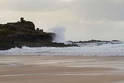© Licensed to London News Pictures. 17/12/2011. St Ives, UK. Waves break against 'Clodgy Point' on Porthmeor Beach, St Ives. The Meteorological Office forecast winds of up to 40mph for the North Cornwall coast throughout Saturday 17th December. Photo credit : Ashley Hugo/LNP