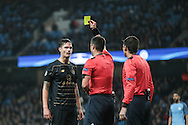 MikaelLustig (Celtic) is booked for dissent by Slavko Vinčić (Referee) during the Champions League match between Manchester City and Celtic at the Etihad Stadium, Manchester, England on 6 December 2016. Photo by Mark P Doherty.