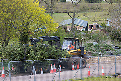 Wendover, UK. 4th May, 2021. Tree surgeons working on behalf of HS2 Ltd clear ancient woodland at Jones Hill Wood in the Chilterns AONB for the HS2 high-speed rail link. Felling of the woodland, which contains resting places and/or breeding sites for pipistrelle, barbastelle, noctule, brown long-eared and natterer's bats and is said to have inspired Roald Dahl's Fantastic Mr Fox, recommenced after a High Court judge refused an application for judicial review and lifted an injunction.