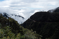 """The The North Yungas Road is a road leading from La Paz to Coroico, 56 kilometres (35 mi) northeast of La Paz in the Yungas region of Bolivia. In 1995 the Inter-American Development Bank christened it as the """"world's most dangerous road"""". In 2006, one estimate stated that 200 to 300 travellers were killed yearly along the road. The road includes cross markings on many of the spots where vehicles have fallen."""