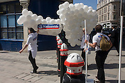 Nationwide Building Society promo people hold down their balloon props in the City of London.